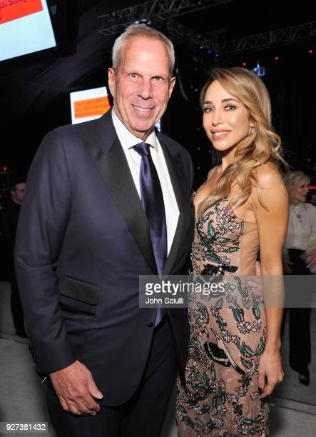 Steve Tisch and Katia Francesconi attends the 26th annual Elton John AIDS Foundation Academy Awards Viewing Party at The City of West Hollywood Park...