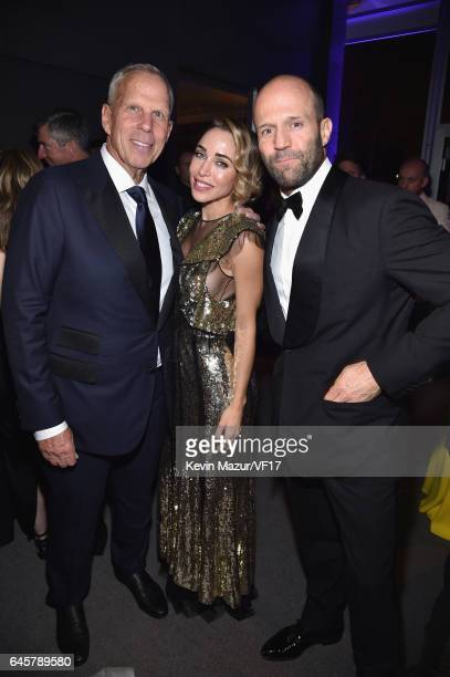 Steve Tisch Katia Francesconi and Jason Statham attends the 2017 Vanity Fair Oscar Party hosted by Graydon Carter at Wallis Annenberg Center for the...