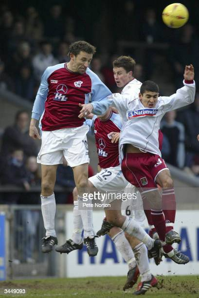 Steve Torpey of Scunthorpe United rises above the Northampton Town defence during the Nationwide League Division Three match between Scunthorpe...