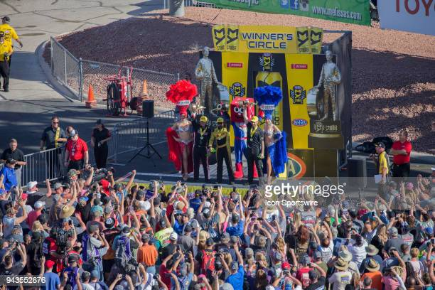 Steve Torrence NHRA Top Fuel Dragster JR Todd Toyota Camry NHRA Funny Car and Vincent Nobile Chevrolet Camaro NHRA Pro Stock celebrate with fans...