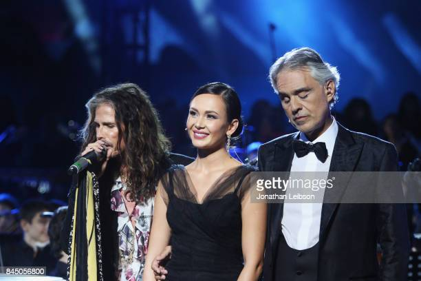 Steve Tyler Aida Garifullina and Andrea Bocelli perform at the Andrea Bocelli show as part of the 2017 Celebrity Fight Night in Italy Benefiting The...