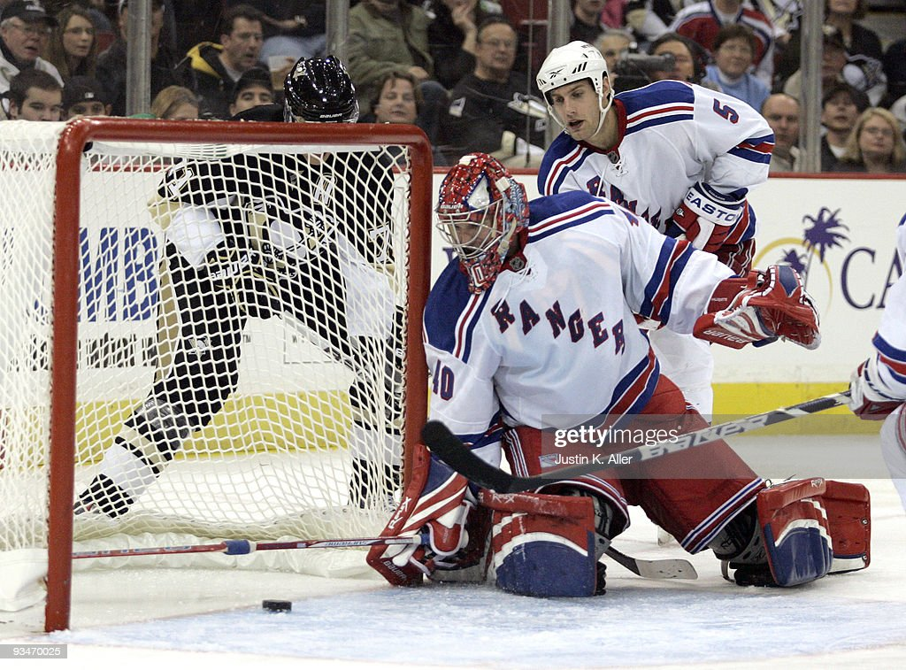 Steve Valiquette #40 of the New York Rangers watches a puck slide throught he crease against the Pittsburgh Penguins in the third period at Mellon Arena on November 28, 2009 in Pittsburgh, Pennsylvania. Penguins won 8-3.