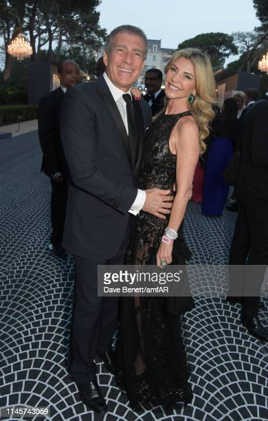Steve Varsano and Lisa Tchenguiz attend the amfAR Cannes Gala 2019 at Hotel du CapEdenRoc on May 23 2019 in Cap d'Antibes France