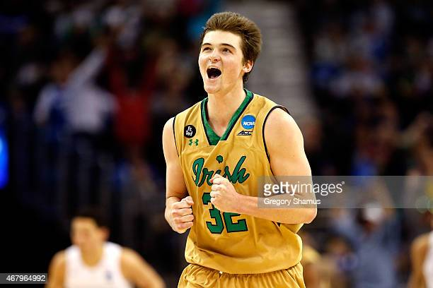 Steve Vasturia of the Notre Dame Fighting Irish celebrates after a play in the second half against the Kentucky Wildcats during the Midwest Regional...