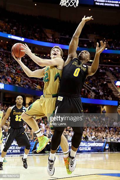 Steve Vasturia of the Notre Dame Fighting Irish drives to the basket against Rashard Kelly of the Wichita State Shockers in the first half during the...