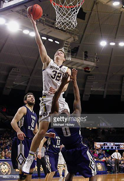 Steve Vasturia of the Notre Dame Fighting Irish shoots the ball over Chris Martin of the Mount St Mary's Mountaineers at Purcell Pavilion on December...