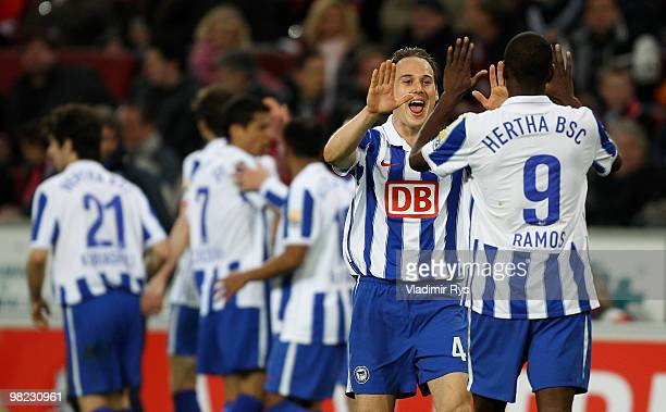 Steve von Bergen and Adrian Ramos of Berlin celebrate the third goal scored by their team mate Cicero during the Bundesliga match between 1 FC Koeln...
