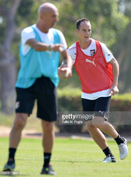 Steve Von Bergen in action as Coach Giuseppe Sannino issues instructions on during a US Citta di Palermo training session at Carmelo Onorato Sports...