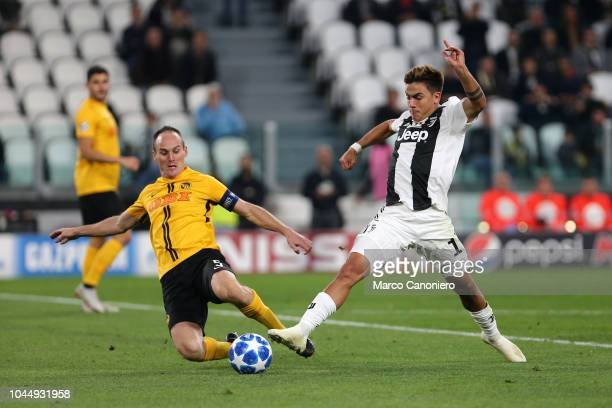 Steve von Bergen of Berner Sport Club Young Boys and Paulo Dybala of Juventus Fc in action during the Uefa Champions League Group H match between...