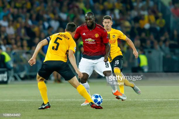 Steve von Bergen of BSC Young Boys Christian Fassnacht of BSC Young Boys and Romelu Lukaku of Manchester United battle for the ball during the UEFA...