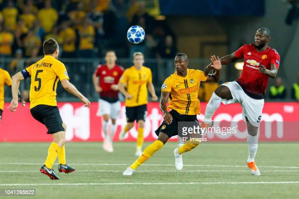 Steve von Bergen of BSC Young Boys Mohamed Ali Camara of BSC Young Boys and Romelu Lukaku of Manchester United battle for the ball during the UEFA...