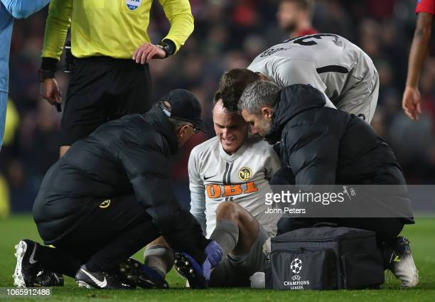 Steve von Bergen of BSC Young Boys receives treatment on an injury during the Group H match of the UEFA Champions League between Manchester United...