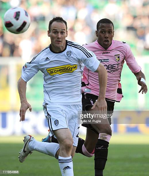 Steve Von Bergen of Cesena and Abel Hernandez of Palermo compete for the ball during the Serie A match between US Citta di Palermo and AC Cesena at...