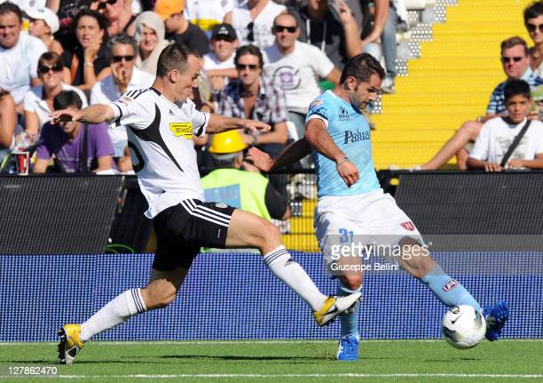 Steve Von Bergen of Cesena and Sergio Pellisier of Chievoin action during the Serie A match between AC Cesena and AC Chievo Verona at Dino Manuzzi...