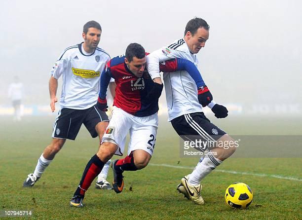 Steve Von Bergen of Cesena shields the ball from Mattia Destro of Genoa during the Serie A match between AC Cesena and Genoa CFC at Dino Manuzzi...