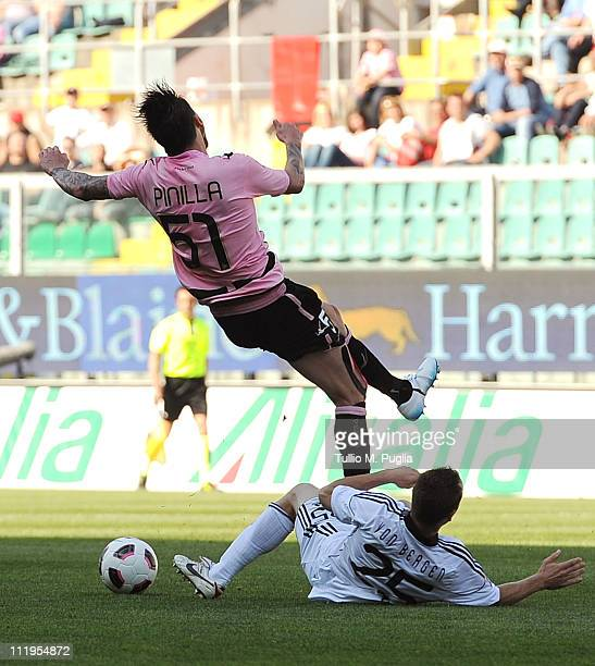 Steve Von Bergen of Cesena tackles Mauricio Pinilla of Palermo during the Serie A match between US Citta di Palermo and AC Cesena at Stadio Renzo...