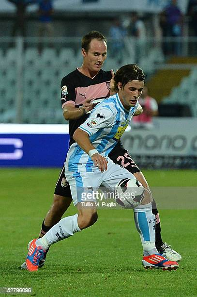 Steve Von Bergen of Palermo and Ante Vukusic of Pescara compete for the ball during the Serie A match between Pescara and US Citta di Palermo at...