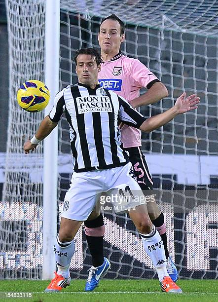 Steve Von Bergen of Palermo and Emanuele Calaio of Siena compete for the ball during the Serie A match between AC Siena and US Citta di Palermo at...
