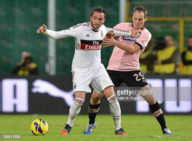Steve Von Bergen of Palermo and Giampaolo Pazzini of Milan compete for the ball during the Serie A match between US Citta di Palermo and AC Milan at...