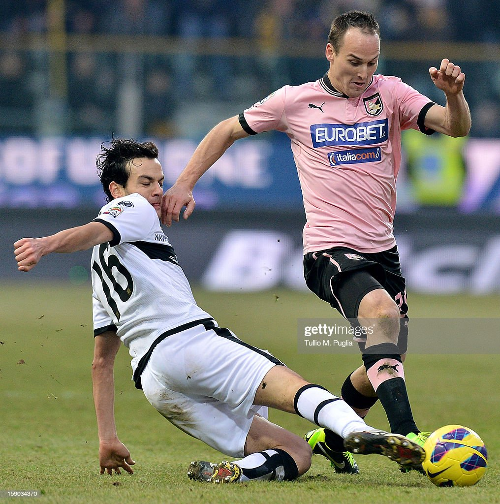 Steve Von Bergen (L) of Palermo and Marco Parolo of Parma compete for the ball during the Serie A match between Parma FC and US Citta di Palermo at Stadio Ennio Tardini on January 6, 2013 in Parma, Italy.