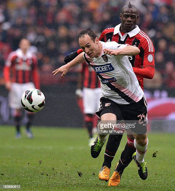 Steve Von Bergen of Palermo and Mario Balotelli of Milan compete for the ball during the Serie A match between AC Milan and US Citta di Palermo at...