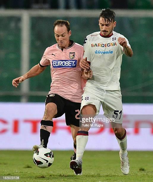 Steve Von Bergen of Palermo and Mauricio Pinilla of Cagliari compete for the ball during the Serie A match between US Citta di Palermo and Cagliari...