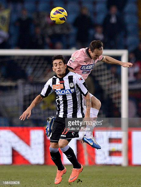 Steve Von Bergen of Palermo and Roberto Maximiliano Pereira of Udinese jump for a header during the Serie A match between Udinese Calcio and US Citta...