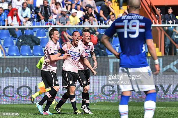 Steve Von Bergen of Palermo celebrates with team mates after scoring the opening goal during the Serie A match between UC Sampdoria and US Citta di...