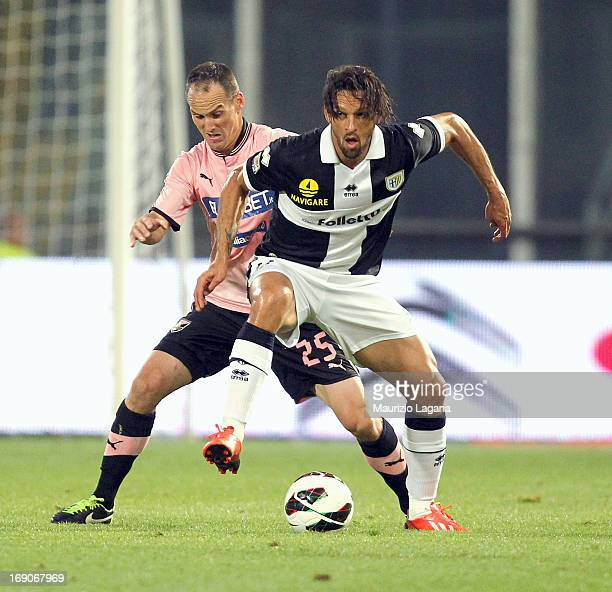 Steve Von Bergen of Palermo competes for the ball with Amauri of Parma during the Serie A match between US Citta di Palermo and Parma FC at Stadio...