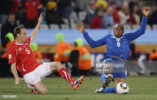 Steve von Bergen of Switzerland and Wilson Palacios of Honduras challenge for the ball during the 2010 FIFA World Cup South Africa Group H match...