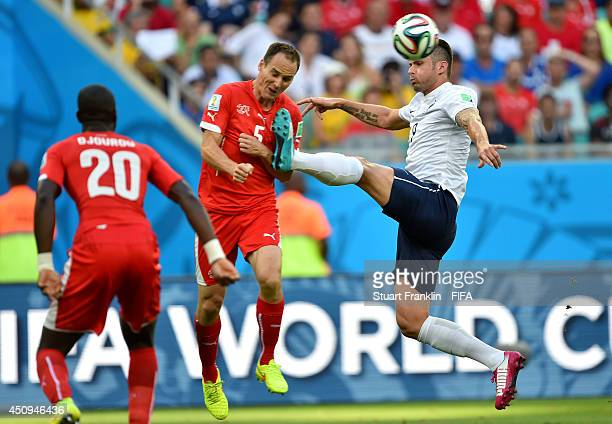 Steve von Bergen of Switzerland collides with Olivier Giroud of France during the 2014 FIFA World Cup Brazil Group E match between Switzerland and...