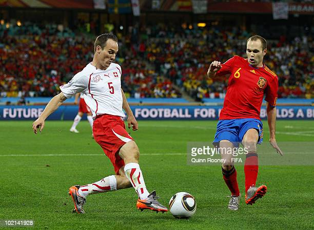 Steve von Bergen of Switzerland is challenged by Andres Iniesta of Spain during the 2010 FIFA World Cup South Africa Group H match between Spain and...