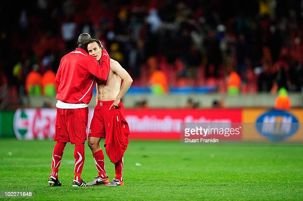 Steve von Bergen of Switzerland is consoled by team mate Blaise Nkufo after defeat in 2010 FIFA World Cup South Africa Group H match between Chile...