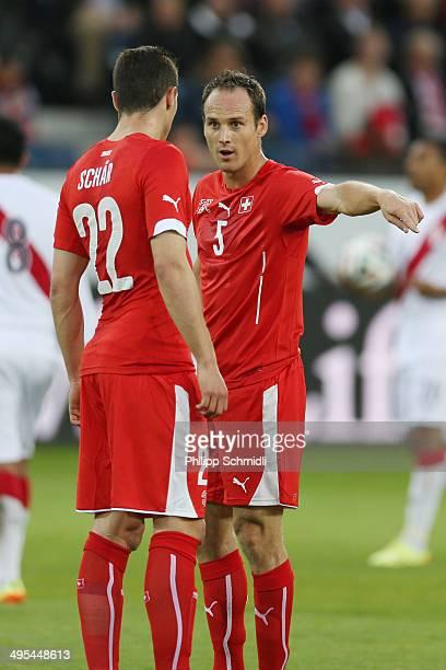 Steve Von Bergen of Switzerland speaks with Fabian Schaer during the international friendly match between Switzerland and Peru at Swissporarena on...