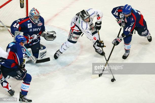 Steve Wagner of Mannheim is challenged by Jimmy Sharrow of Berlin during the DEL match between Adler Mannheim and Eisbaeren Berlin at SAP Arena on...