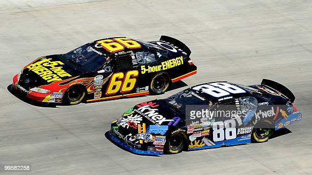 Steve Wallace driver of the 5Hour Energy Toyota races with Jamie McMurray driver of the KNex Chevrolet during the NASCAR Nationwide Series Heluva...