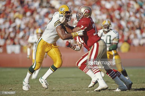 Steve Wallace Tackle for the San Francisco 49ers blocks Linebacker Tim Harris of the Green Bay Packers during their National Football Conference West...