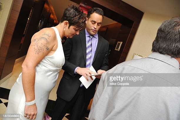 Steve Ward Of VH1's 'Tough Love' and Mrs Sheila Martin speak at a wedding for 11 couples at the Crowne Plaza Times Square on November 11 2011 in New...