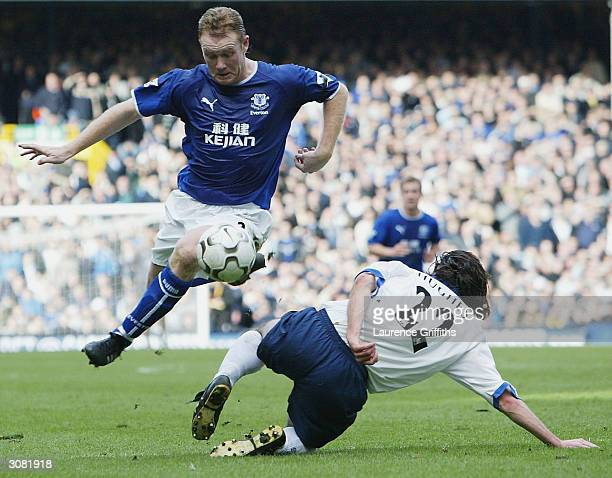 Steve Watson of Everton skips past Richard Hughes of Portsmouth during the FA Barclaycard Premiership match between Everton and Portsmouth at...