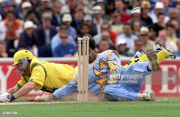 Steve Waugh of Australia collides with Robin Singh of India during an attepted run out at the Oval in London 04 June 1999 during the first match in...