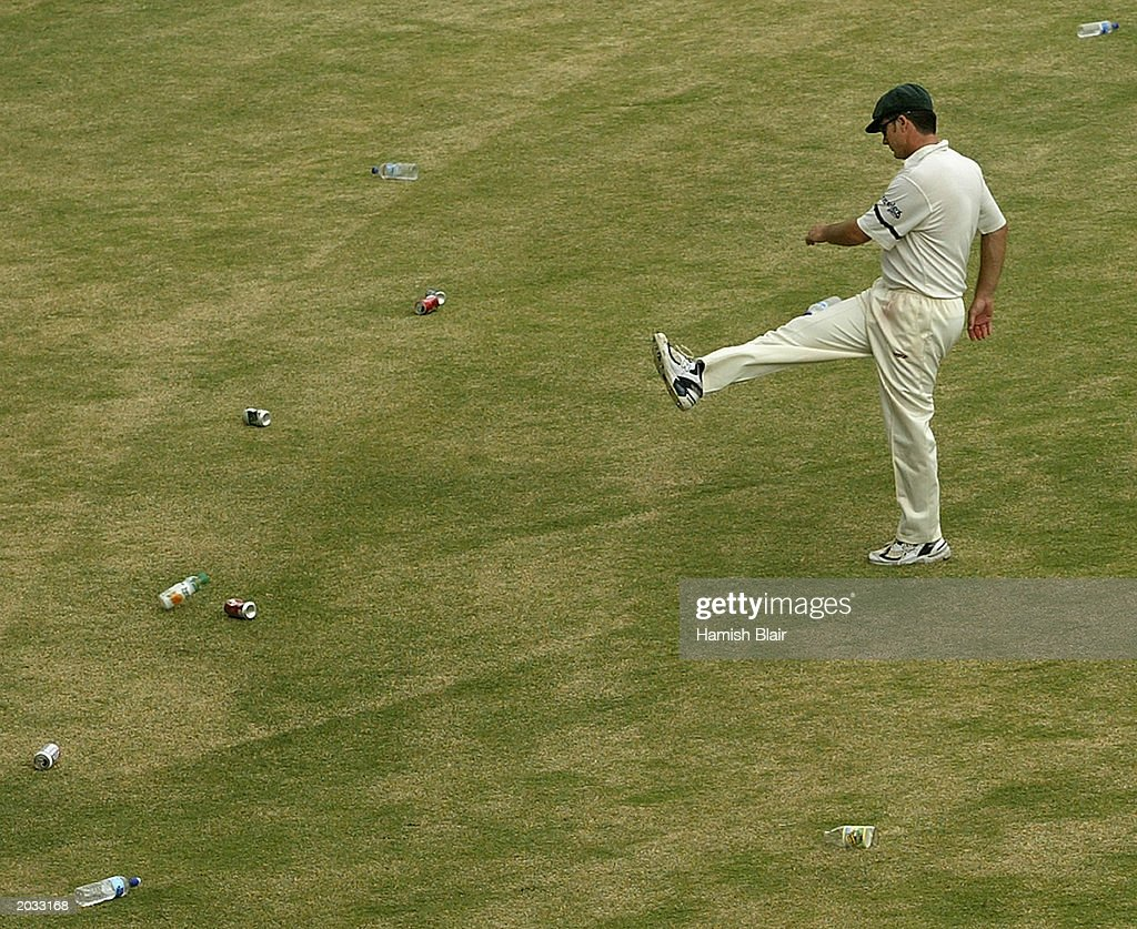 Steve Waugh of Australia kicks bottles from the ground after the crowd through them in protest of the dismissal of Ridley Jacobs of the West Indies during day four of the fourth test between the West Indies and Australia played on May 12, 2003 at the Recreation Oval in St John's, Antigua.