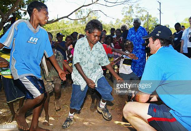 Steve Waugh of Australia looks on as locals perform a traditional dance to welcome the Australian Team on July 22 2003 during a team visit to an...