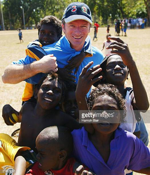 Steve Waugh of Australia meets some locals on July 22 2003 during a team visit to an Aboriginal settlement on Melville Island off the coast of Darwin...