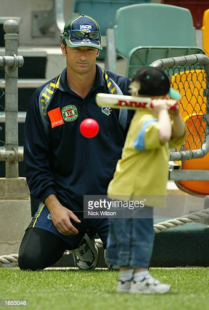 Steve Waugh of Australia plays with son Austin during the Australian Cricket Teams nets session ahead of the First Ashes Test between Australia and...