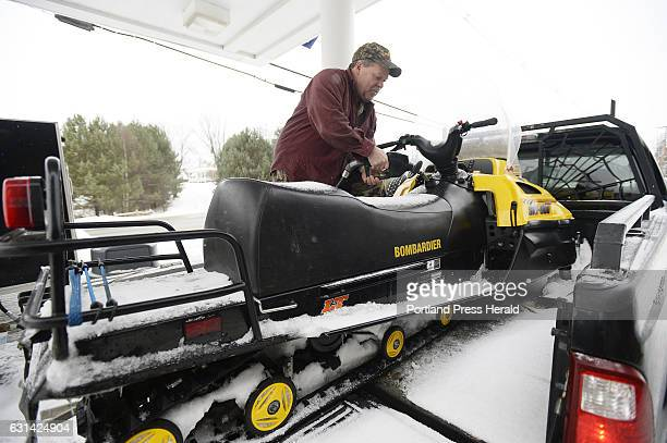 Steve Waugh of Mexico Maine fills his snowmobile with gas at Loony Bin Variety on Main St in Rangeley Wednesday December 28 2016