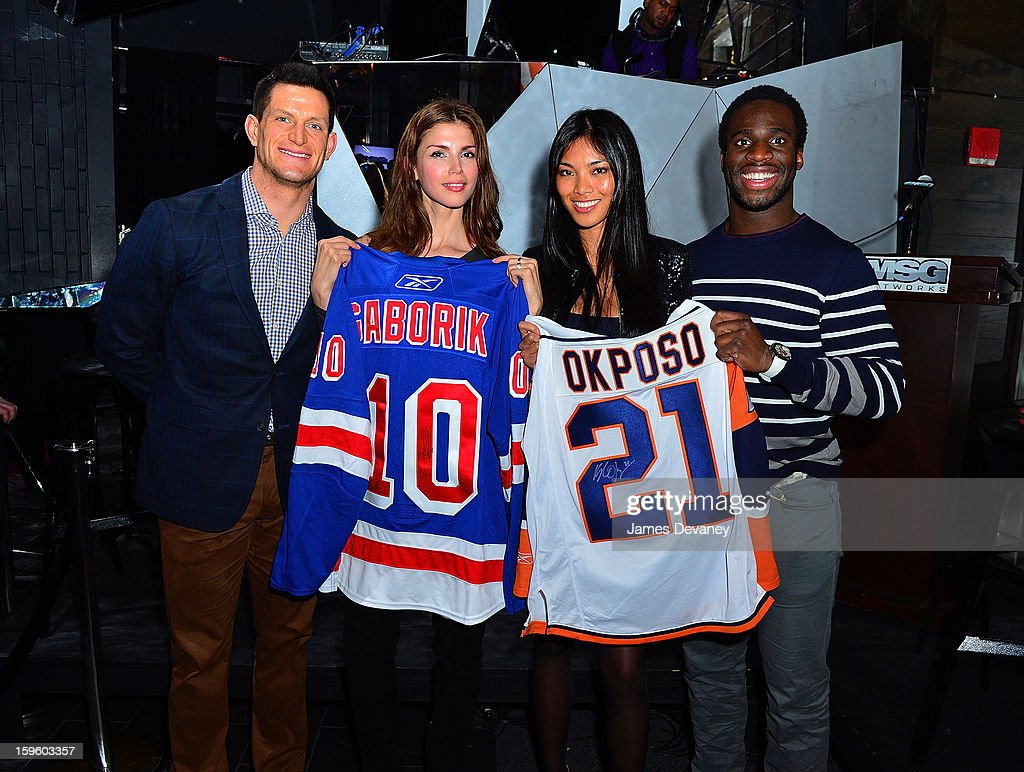 Steve Weatherford, Alejandra Cata, Meki Saldana and Prince Amukamara attend MSG Networks' 2013 NHL Hockey Season Celebration at Toy Restaurant on January 16, 2013 in New York City.