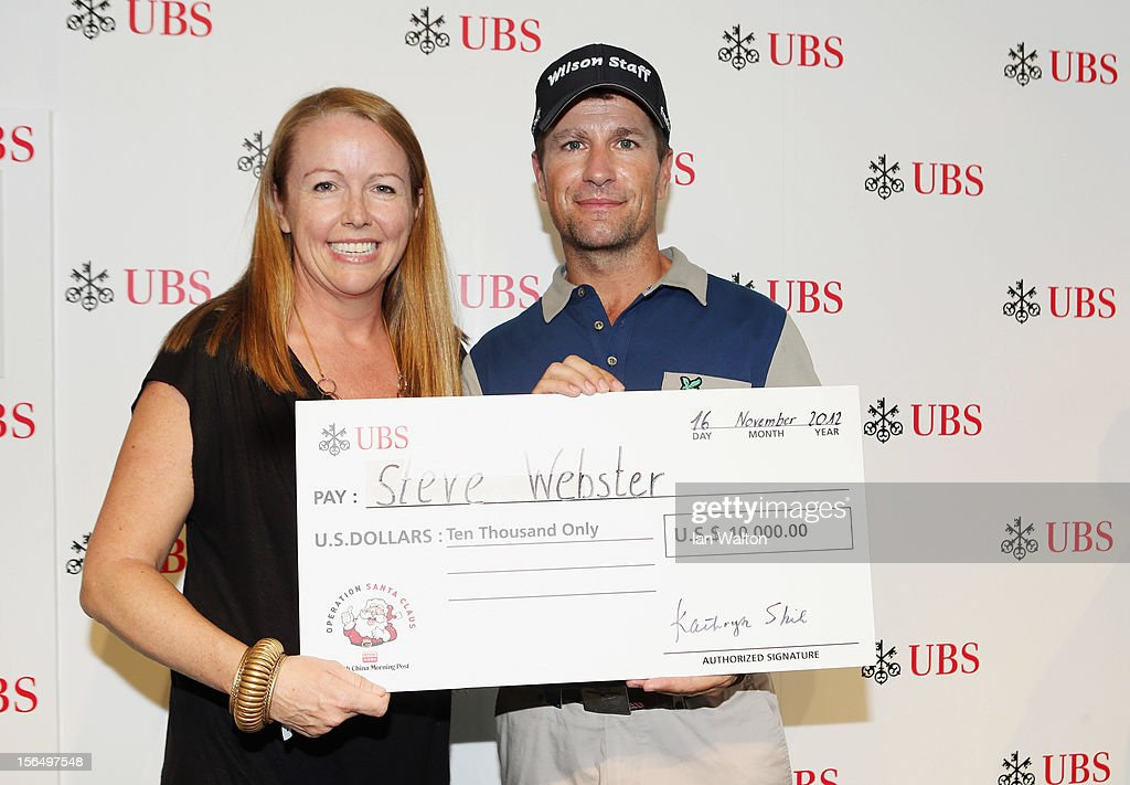Steve Webster of England receives a cheque from Caroline Darcy UBS Exeutive director head of Sponsorship after a hole in one during round two of the UBS Hong Kong Open at The Hong Kong Golf Club on November 16, 2012 in Hong Kong, Hong Kong.