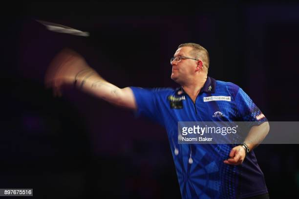 Steve West of England in action during the second round match against Jermaine Wattimena of the Netherlands on day ten of the 2018 William Hill PDC...