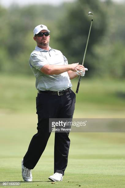 Steve Wheatcroft hits his approach shot on the 18th hole during the first round of the John Deere Classic at TPC Deere Run on July 12 2018 in Silvis...