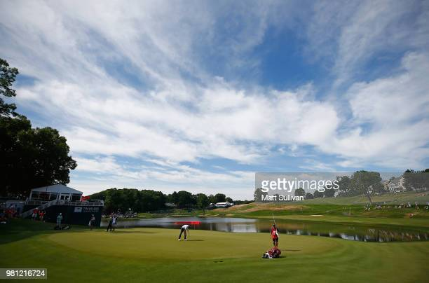 Steve Wheatcroft watches his second shot on the 18th hole during the second round of the Travelers Championship at TPC River Highlands on June 22...
